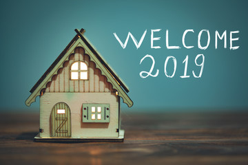 welcome 2019 text and house model