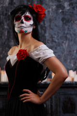 Image of zombie girl with makeup and roses on face
