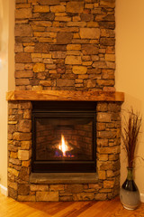 Stone fireplace with gas logs on a cold, winter night.