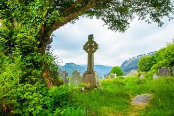Ancient celtic cross in Glendalough, Ireland