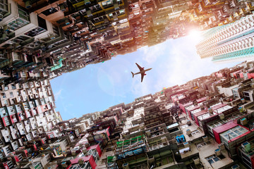 Fotobehang Aziatische Plekken Plane Flying Over Crowded Houses in Quarry Bay, Hong Kong