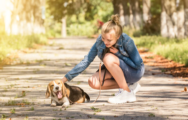 Blond girl sitting with puppy