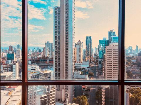 view from skyscraper window on modern city skyline