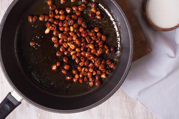 Fried hazelnuts in a pan