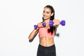 Sporty woman doing boxing exercises, making direct hit with dumbbells. Strength and motivation
