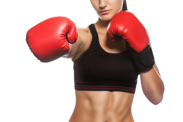 A beautiful sportswoman is boxing in the gym. Doing sports and sports life.