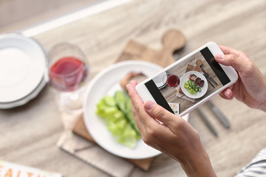 Blogger taking photo of food with mobile phone, closeup. Space for text