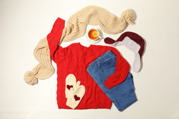 Fototapete - Flat lay composition with set of stylish winter outfit on white background
