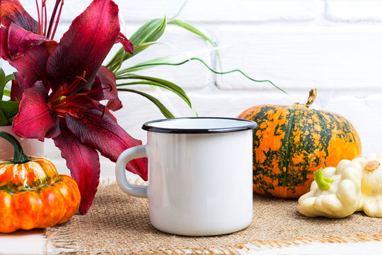 White campfire mug mockup with pumpkin and red lily