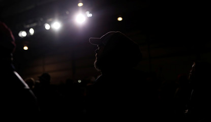 Supports listen to U.S. President Donald Trump speaking at a campaign rally at the Columbia Regional Airport in Columbia Missouri