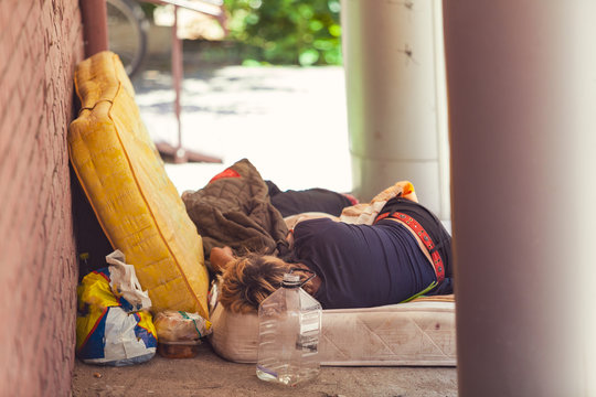 Homeless person sleeping on a mattress