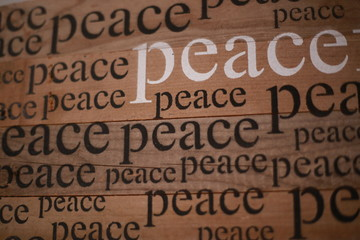"The words ""peace"" written on a wall"