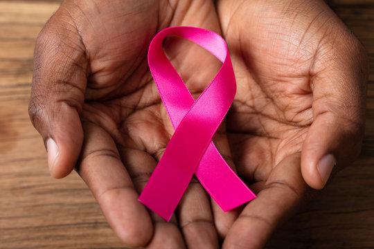 Man Holding Pink Ribbon