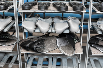 The conveyor on a shoes factory with shoe and sole. Mass production of footwear.