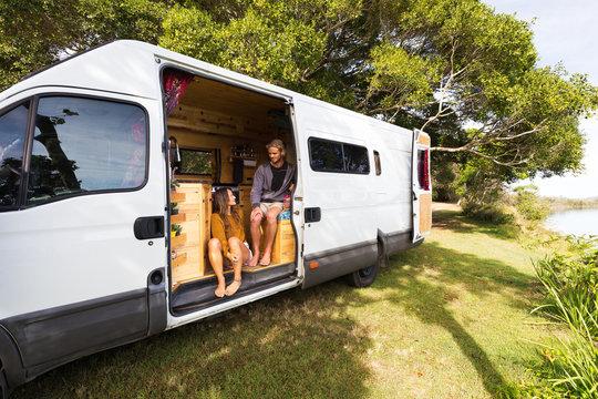 Van life couple in bohemian camper van at a scenic Australian location