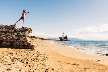 Tourist take photo on beach sea shore