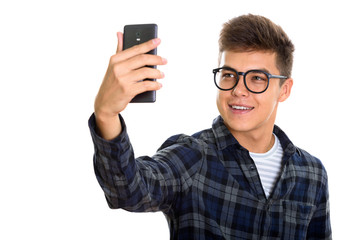 Young happy man smiling while taking selfie picture mobile phone