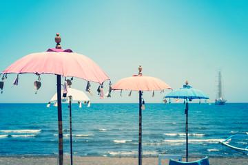 colorful umbrella beach on sunny summer day