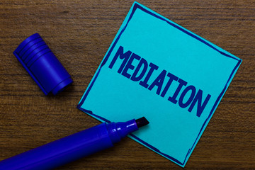 Writing note showing Mediation. Business photo showcasing intervention dispute in order to resolve it Arbitration Relaxation Blue Paper Important reminder Communicate ideas Wooden background