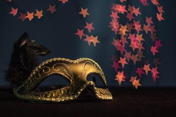 Carnival mask on the background of festive lights.