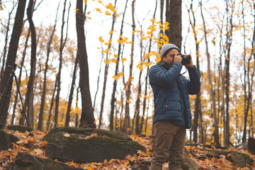 Man taking pictures in a forest