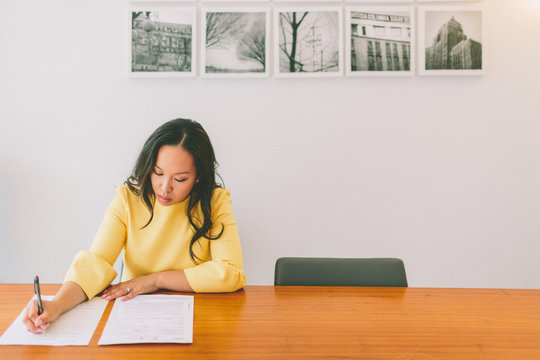 a professional woman sign a contract
