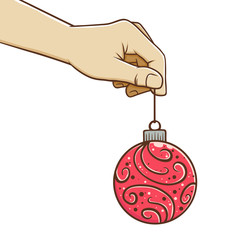 Hand Holding Christmas Ball Ornament