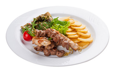 Set of kebabs with vegetable garnish on a white plate
