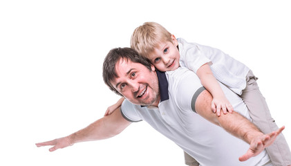 concept of children's happiness: happy father playing with his five year old son