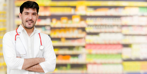 Young male pharmacist working at the pharmacy. Medical healthcare and pharmaceutical service.