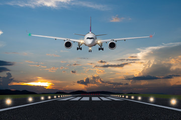 Aluminium Prints Airplane Airplane landing in the evening with beautiful sunset background