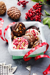Luxury handmade chocolate mediants, cookies, bites in a gift box. Traditional french Christmas dessert.