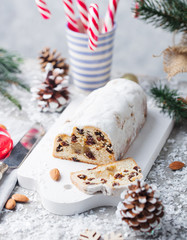 Christmas stollen cake with icing sugar, marzipan and raisins. Traditional Dresdner christ pastry.