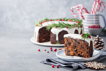 Christmas fruit cake, pudding on white plate. Traditional New Year dessert. Copy space.