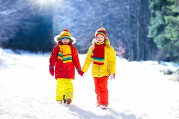 Kids winter snow ball fight. Children play in snow