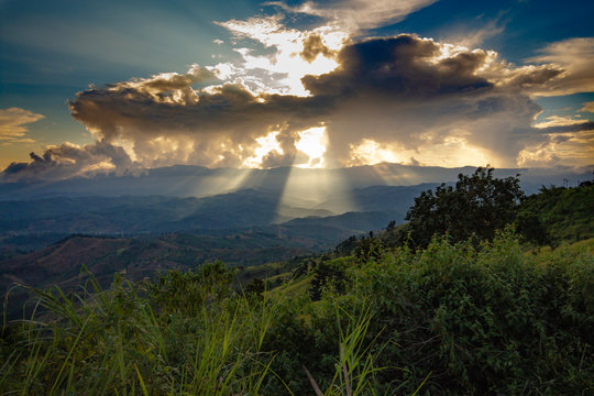 sun burst out from back of a cloud. Above mountain sunbeam hope and dream concept. The grand power of nature.