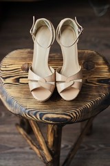 Wooden chair on it pink high-heeled sandals
