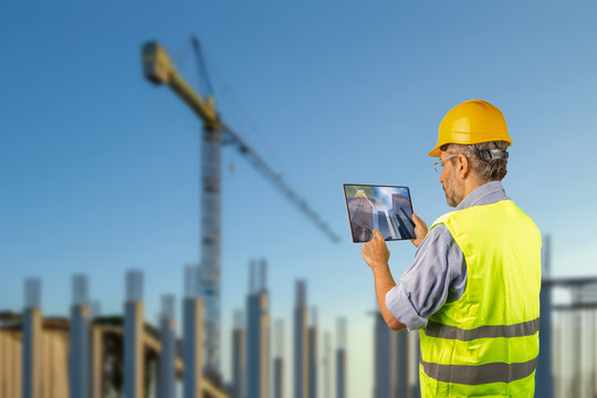 engineer touching tablet monitor in a construction site