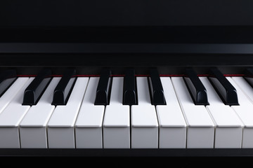 Grand piano keyboard with glossy black and white keys as a music, Select focus and soft focus.