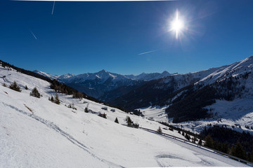 Wintery mountain landscape with sunshine