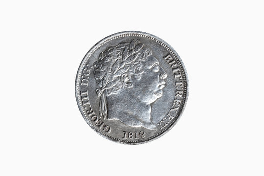 Old pre decimal 1819 George III silver sixpence coin of the United Kingdom cut out and isolated on a white background