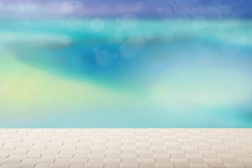 Table top on sunny beach background. A Empty bright table on blurred abstract tropical beach with  blue sky. Template for your product display montage. Summer and holiday concept.