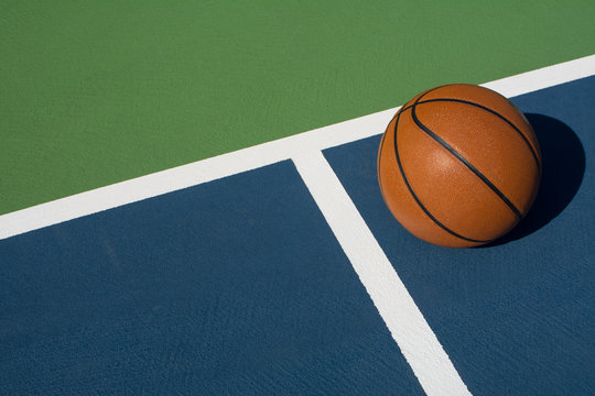 Basketball rests on court