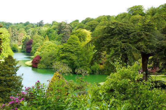 Lake in mature garden in spring
