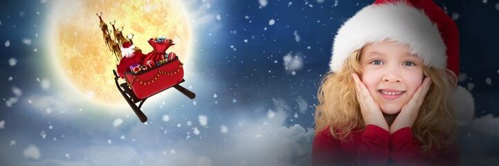 Composite image of cute girl in santa hat