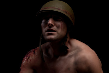 a military soldier struggles show his scars with open wounds