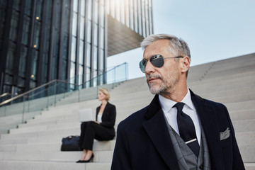 Portrait of fashionable mature businessman wearing sunglasses