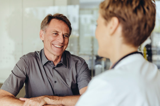 Female doctor talking to patient in practice