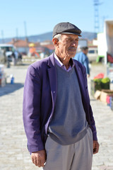 close-up portrait of happy senior man. Elderly Turkish Man Portrait who lives in a small town of Turkey.