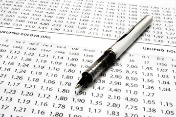 A sport betting list with pen
